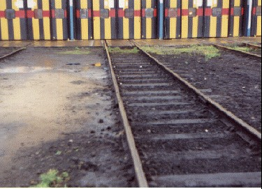 oil contaminated rail depot before treatment